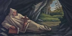 San Bruno in preghiera in una grotta
